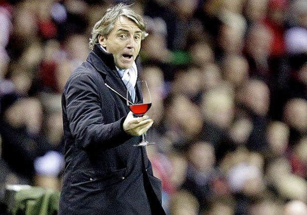 rd ROBERTO MANCINI DABS WINE BEHIND HIS EARS, DOESN'T PAY FOR DINNER